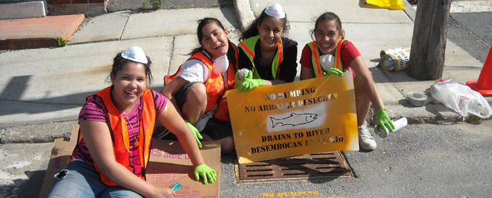 NRWA volunteers stencil warnings on storm drains to help prevent pollution - Photo by Martha Morgan