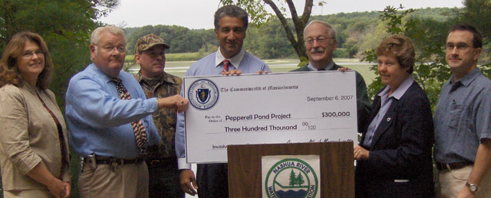 A state and local partnership to control invasive water chestnuts in the Nashua River - Photo by Wynne Treanor-Kvenvold