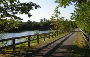 The Nashua River Rail Trail runs from Ayer, MA to Nashua, NH